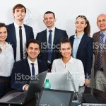 Portrait of positive corporate managers in office interior